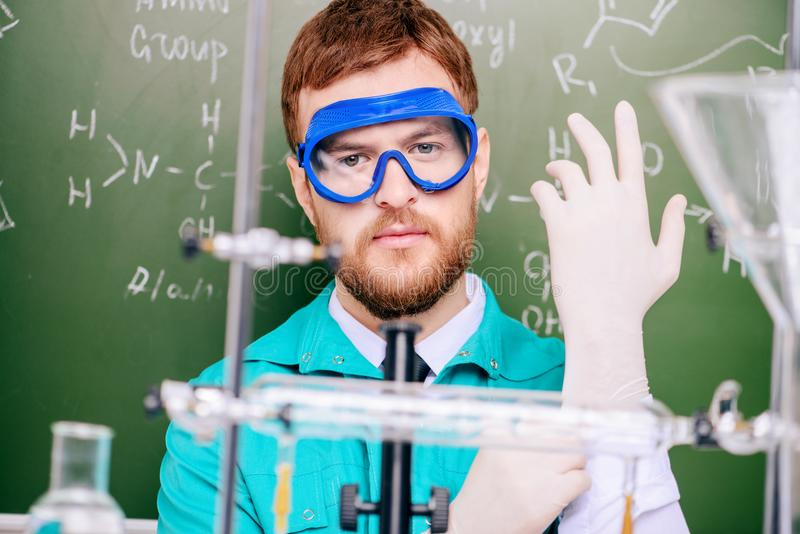Important chemical experiments. Smart man scientist making chemical experiments in the laboratory. Educational concept. Discovery stock images