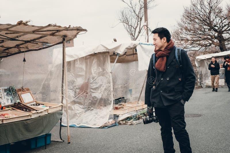 Smart man in Takayama old town market, Japan stock photo