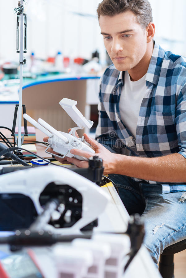 Smart man working with drone mechanism stock photo
