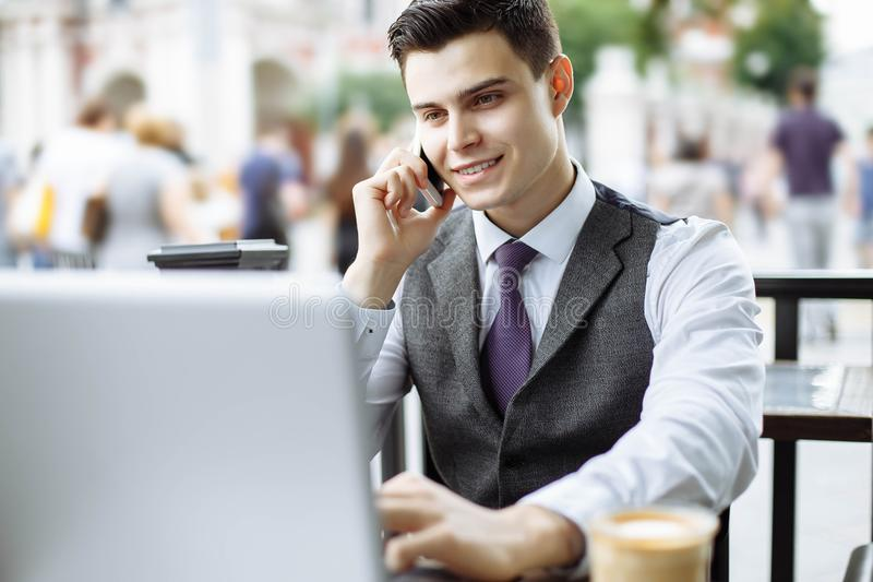 Smart manager having coffee break and talking on the phone in cafe stock photos