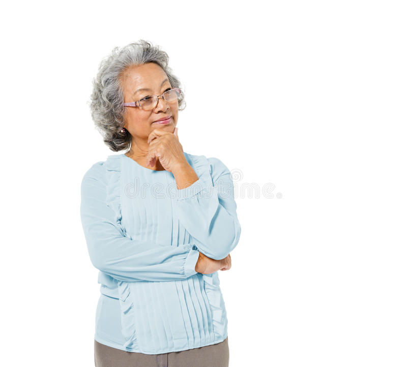 Smart Mature Asian Woman Thinking stock photography