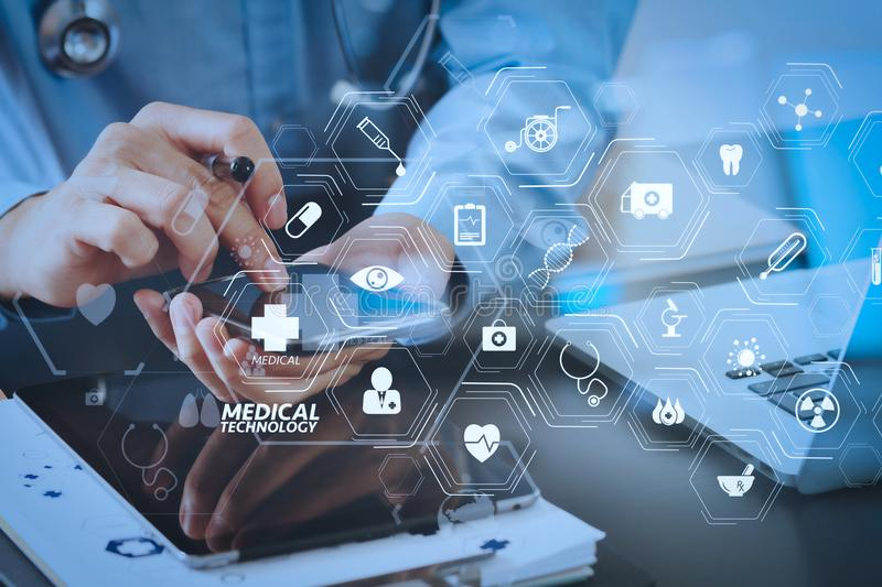 Smart medical doctor working with smart phone and stethoscope an. Modern VR with medical technology diagram concept.smart medical doctor working with smart phone stock image