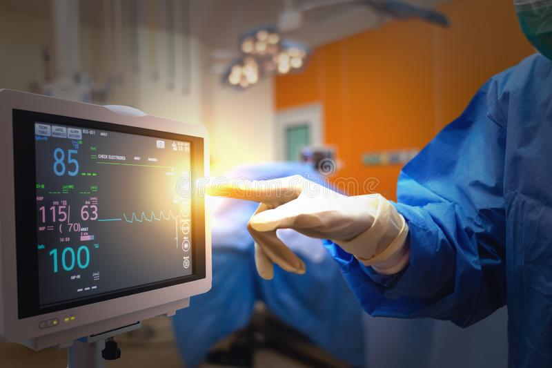 Smart medical technology in hospital concept, doctor in Surgeons team field holding medical instruments for surgery the patient in stock images