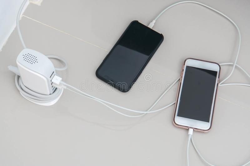 Smart mobile phone charge battery with USB hub royalty free stock image