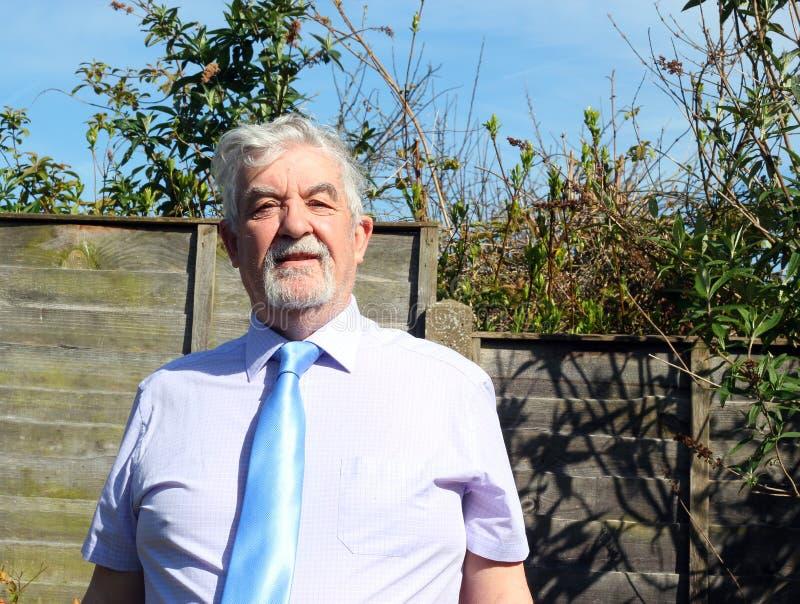 Smart older business man wearing a necktie. stock photo