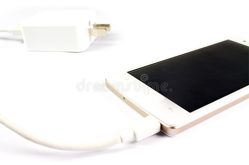 Smart phone and adapter cable royalty free stock photography