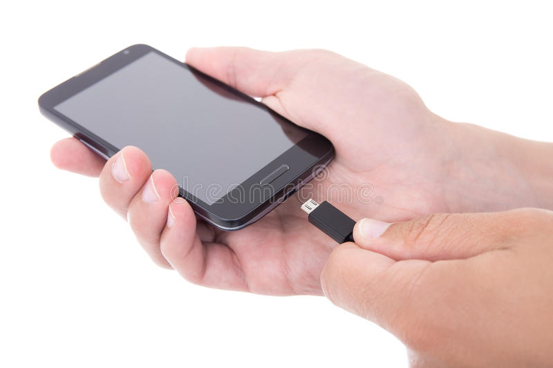 Smart phone with blank screen and charger in hand isolated on wh royalty free stock photos