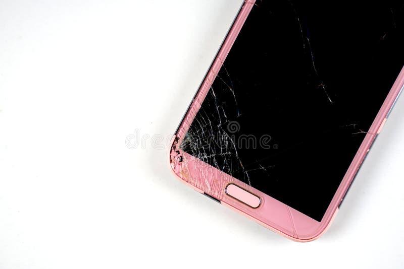 Mobile phone in screen broken. Smart phone in broken glasses stock photo