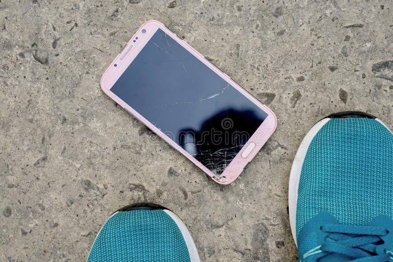 Mobile phone in screen broken. Smart phone in broken glasses stock image