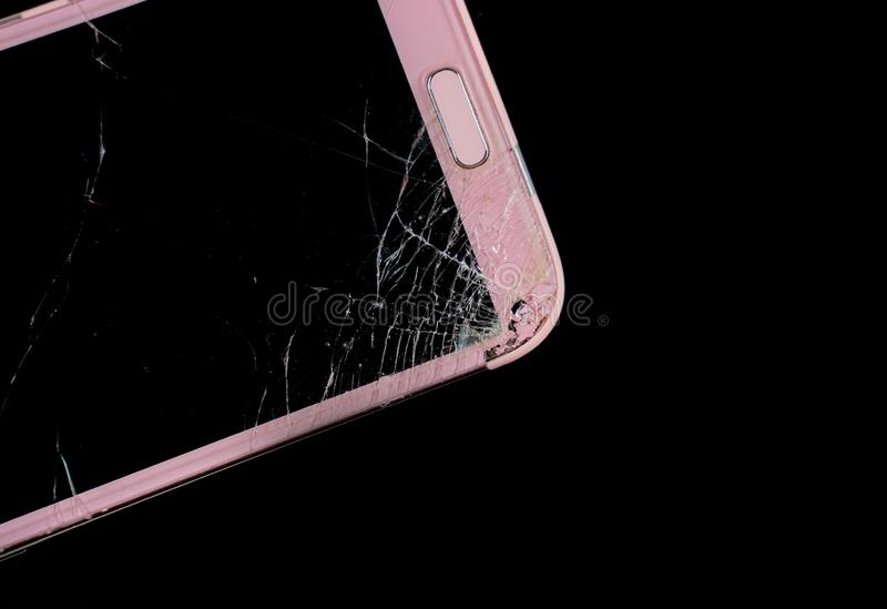 Mobile phone in screen broken. Smart phone in broken glasses royalty free stock images