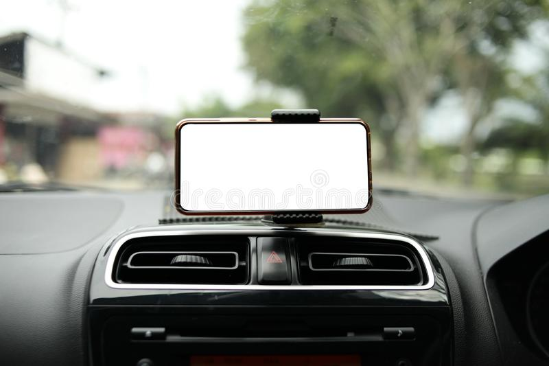 Smart Phone on Car Mock Up. Close up image of smart phone on car mock up, riding a car with smartphone map navigation concept, blank phone screen template empty stock photos