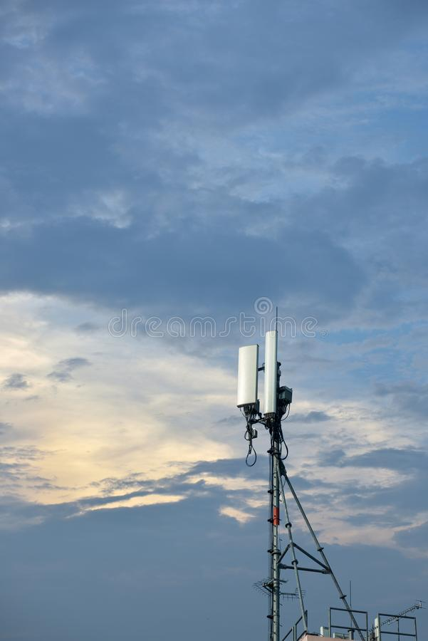 Smart phone and cellular phone pole in the sun set atmosphere. royalty free stock photo