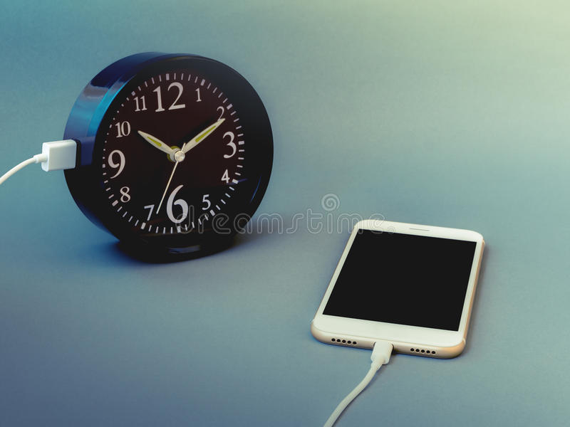 Smart phone charging time from clock royalty free stock photos