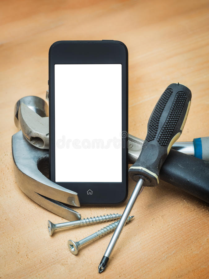 Smart phone and construction tools. stock photo