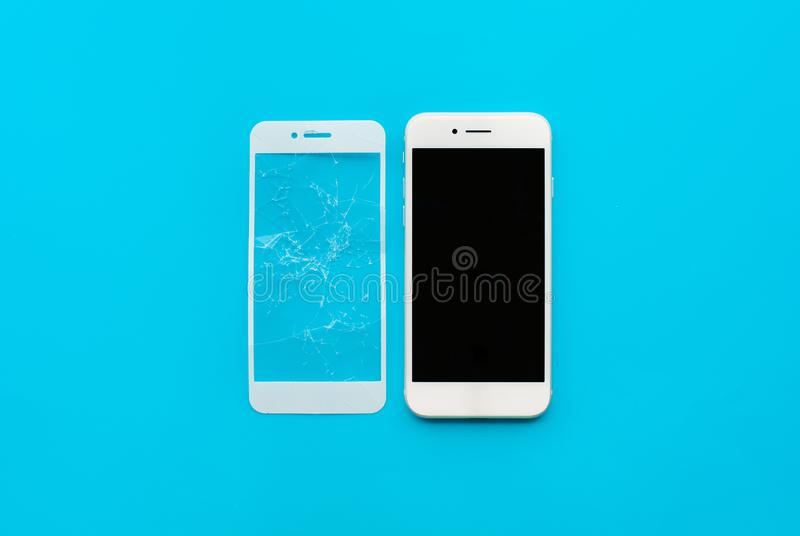 Smart phone with cracked tempered glass shield,film screen cover. Protector concepts ideas royalty free stock image