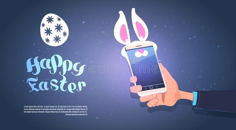 Smart Phone della tenuta della mano con Bunny Ears Happy Easter Background con lo spazio della copia illustrazione vettoriale