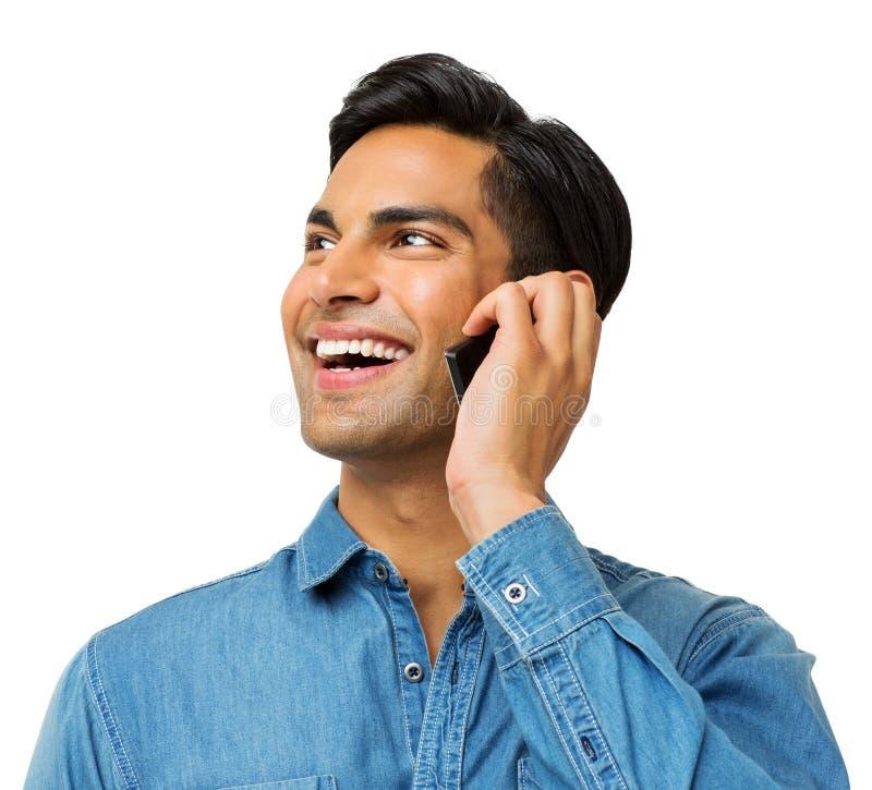 Smart Phone di risposta dell'uomo mentre distogliendo lo sguardo immagine stock