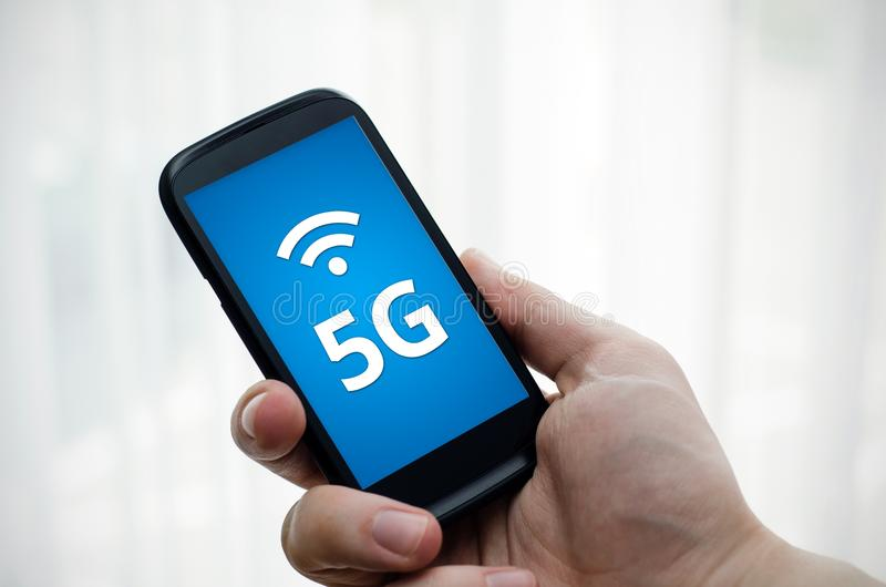 Smart phone with 5G network communication. Smart phone with 5G network standard communication stock image