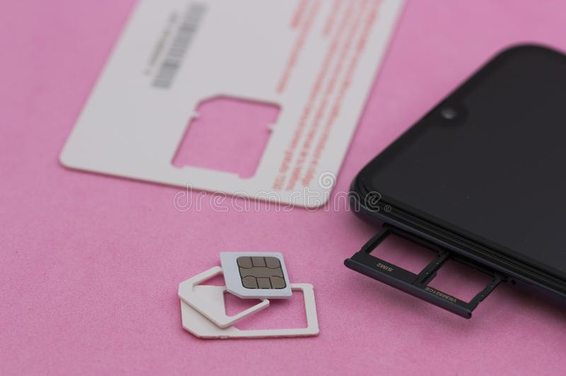 SIM card and a smartphone with dual slot stock images