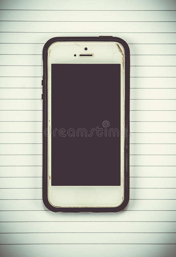 smart phone on note book background. stock photo