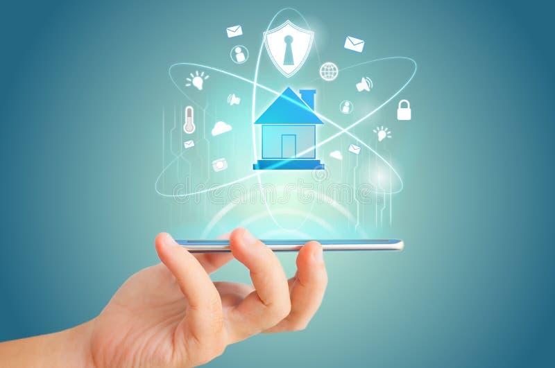 Smart Phone Remote per l'ologramma di una casa intelligente immagini stock