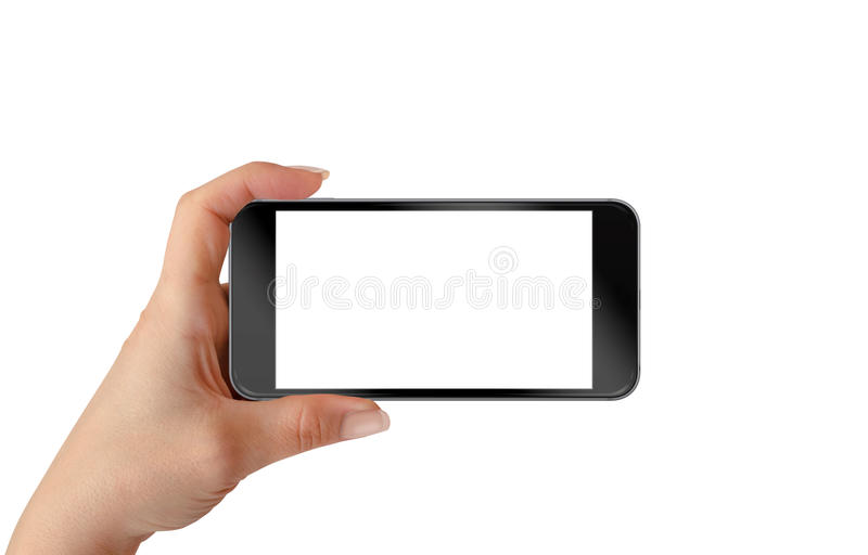 Smart phone in woman hand. Horizontal position royalty free stock photography