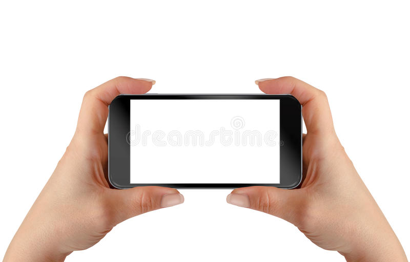 Smart phone in woman hands. Horizontal position royalty free stock photo