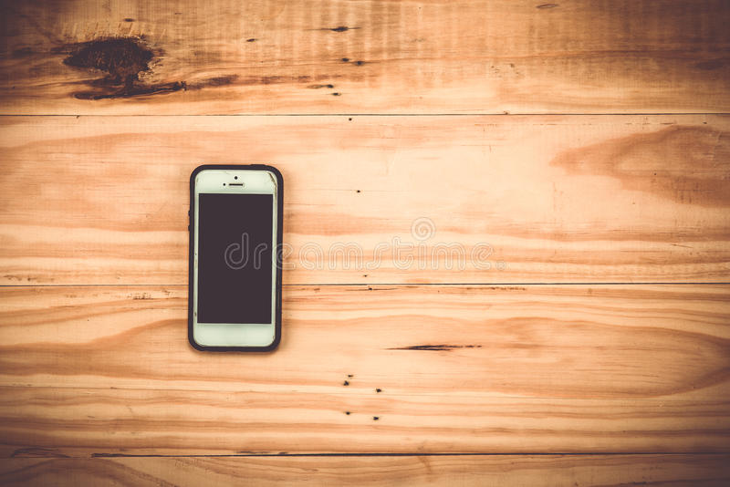 smart phone on wooden background. royalty free stock photography