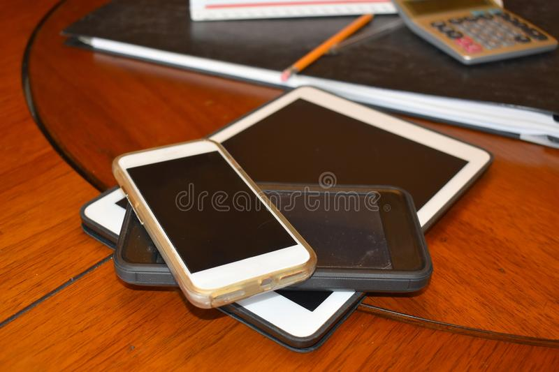 Tablet and smart phones used in business royalty free stock image