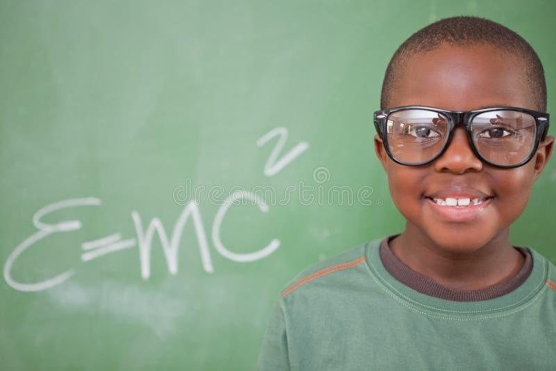 Smart posera för schoolboy arkivbilder