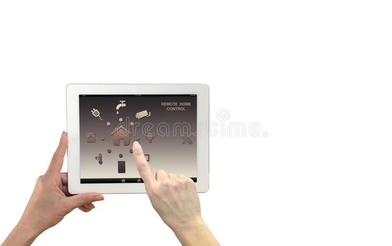 Smart remote home control system on a digital tablet. Woman hands holding device with app icons. royalty free stock photography