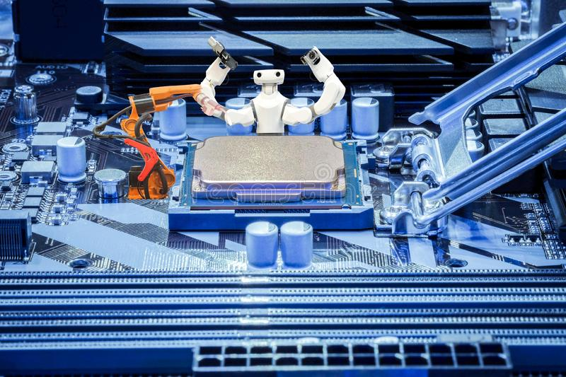 Smart robot and industrial robotic welding working with CPU processor on PC motherboard concept stock image