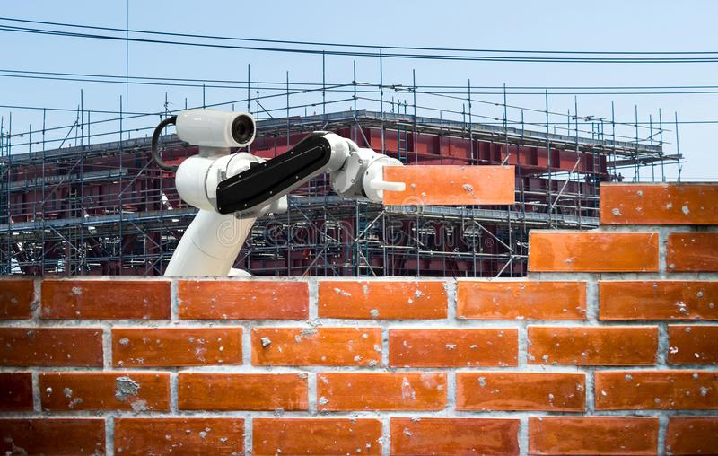 Smart robot industry 4.0 arm brick building construction human force remote royalty free stock images