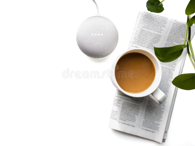 Smart speaker with Coffee and Newspaper. Top View. royalty free stock photography