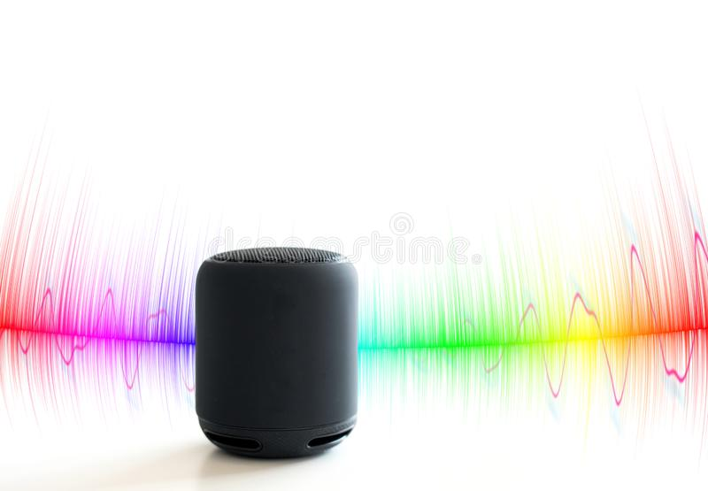 Smart speaker with colorful sound waves stock image