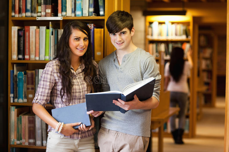 Download Smart students with a book stock image. Image of people - 21145721