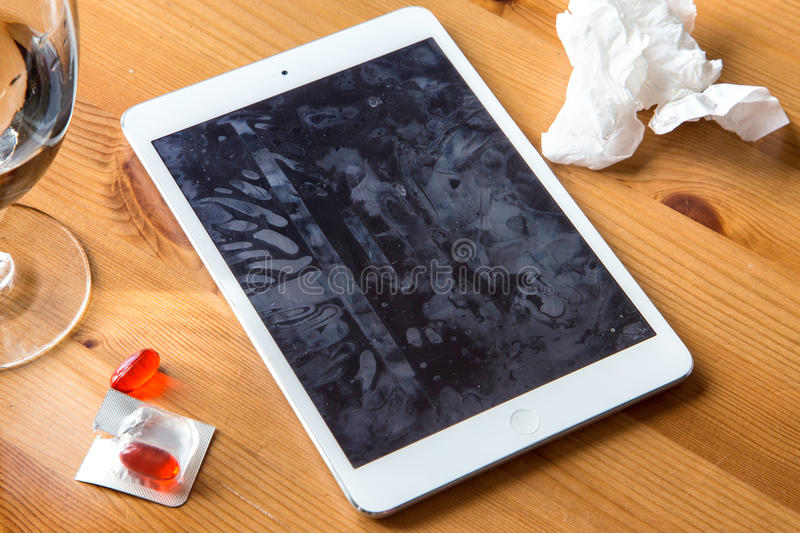Smart tablet cell phone spreads common cold flu from not clean dirty hands spreading germs and bacteria. Flu cold influenza germs spread virus on smartphone and royalty free stock photo
