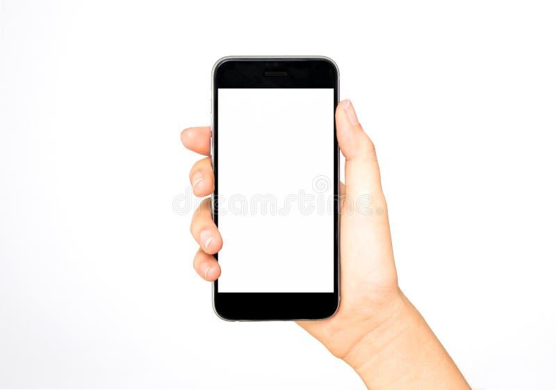 Smart telefon för flickainnehav i hand arkivfoton