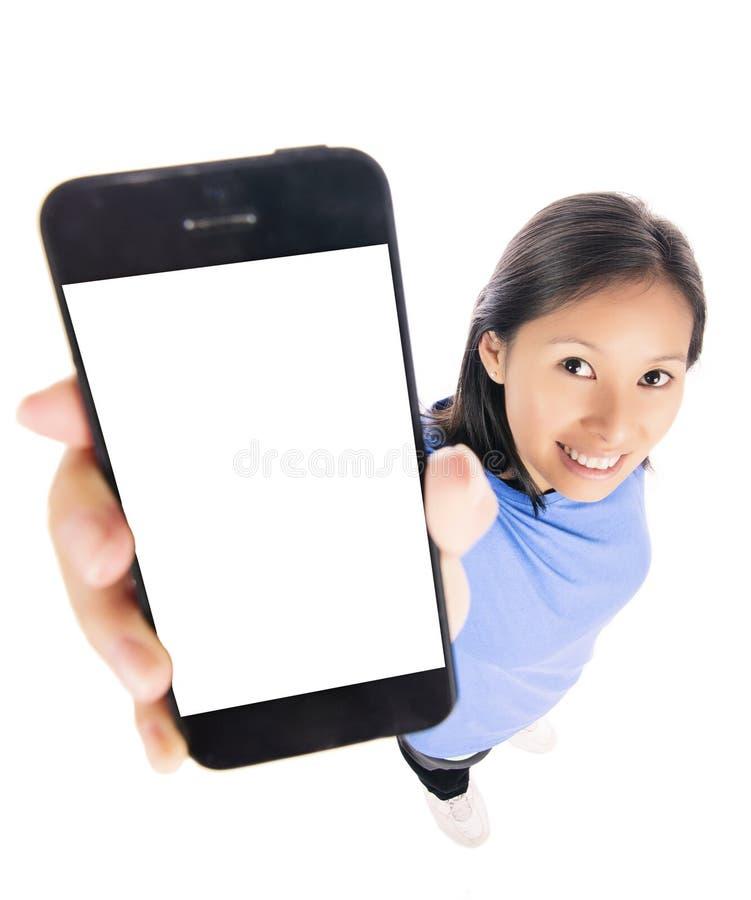 Smart telefon för kvinnavisning royaltyfria bilder
