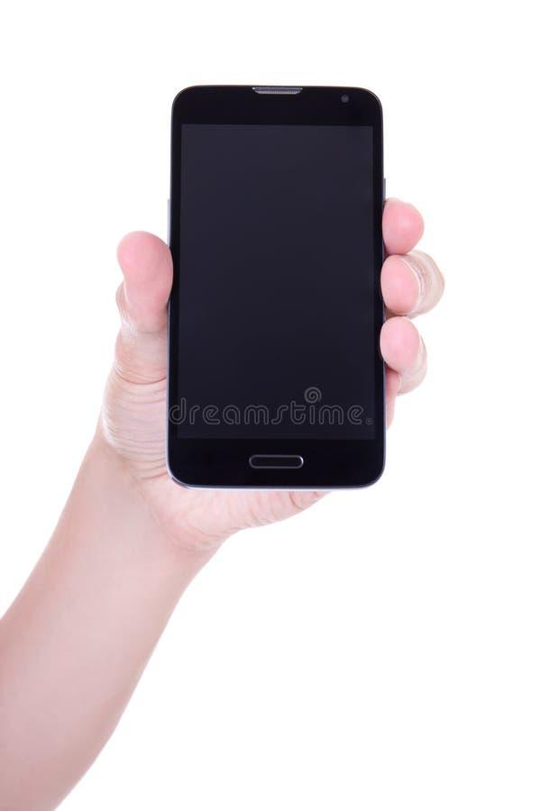 Smart telefon för mobil med den tomma skärmen i den manliga handen som isoleras på wh arkivbilder
