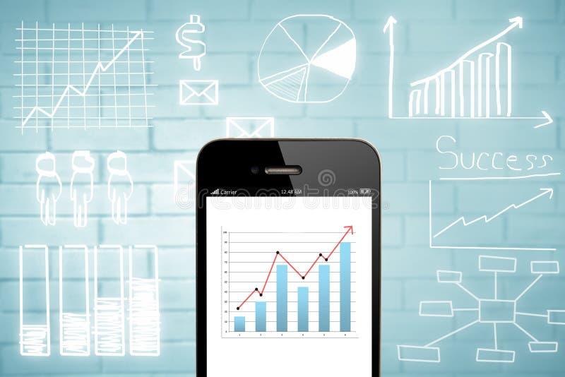 Smart telefon- och affärsdiagram arkivbild