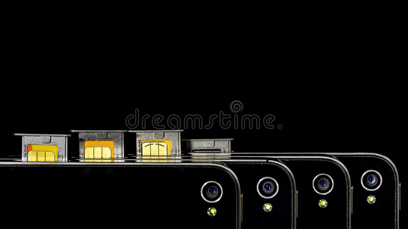 Smart telefoncamersshow med SIM-kortet arkivfoto