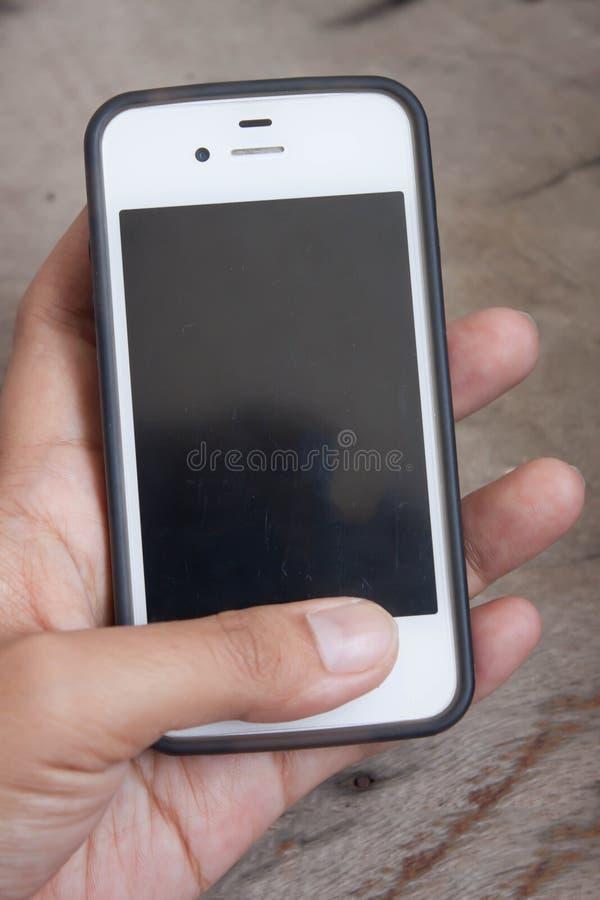 Smart telefoner i händerna fotografering för bildbyråer