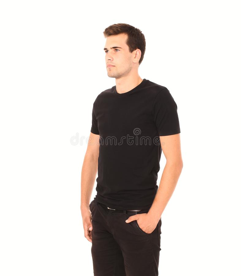 Smart thinking young man in black template blank shirt isolated on white. Copy space. Mock up. Summer t-shirt clothes. Smart thinking young man in black shirt royalty free stock photo
