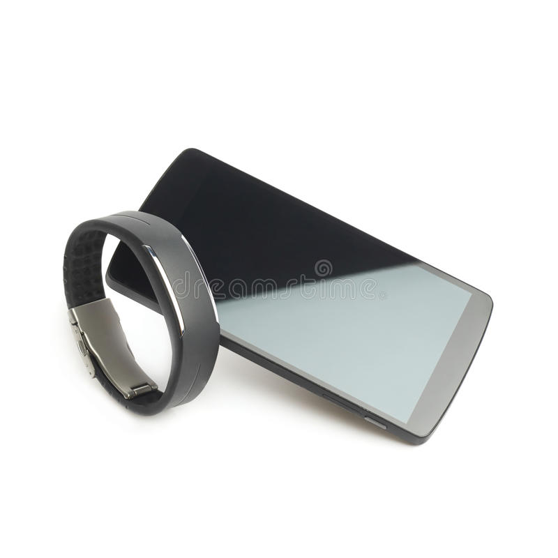 Smart watch and phone isolated. Composition of black smart watch wrist band paired with phone, isolated over the white background royalty free stock photo