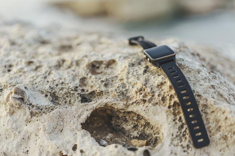 Smart watch on rock royalty free stock photography