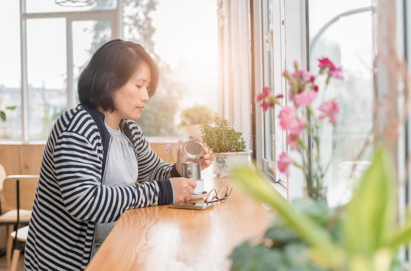 Smart woman drinking black coffee in coffee shop royalty free stock images