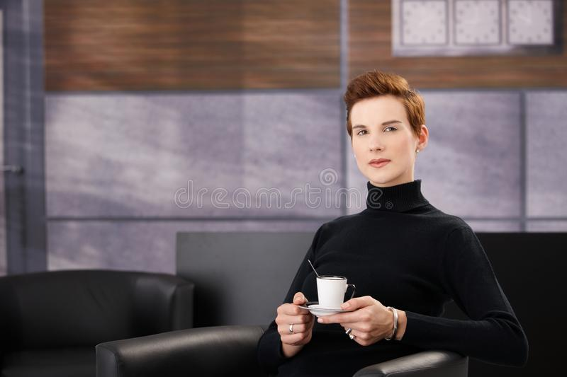 Download Smart woman having coffee stock image. Image of american - 17787633