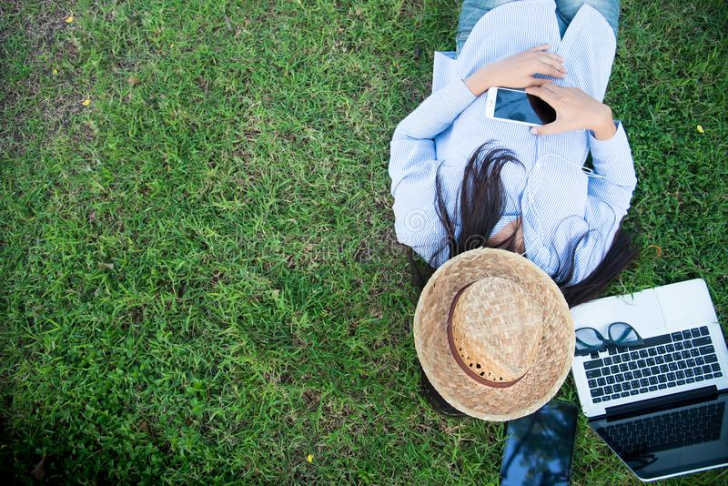 Smart woman working outdoor. Freelance Using laptop smart tablet and smart phone royalty free stock images