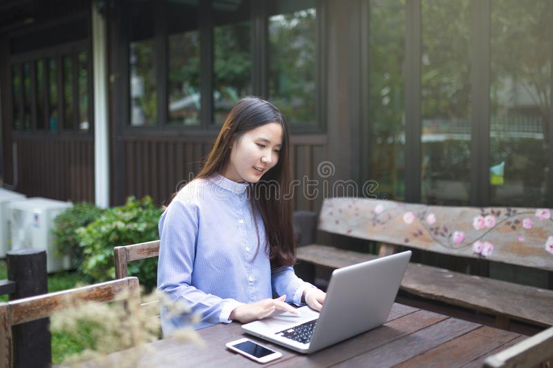 Smart women using laptop and smartphone and technology royalty free stock photo